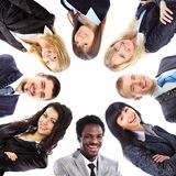 Group of business people standing in huddle Stock Photos