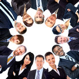Group of business people standing in huddle Royalty Free Stock Photos