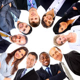 Group of business people standing in huddle Stock Photography