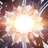 Group of business people standing in huddle, smiling, low angle view. stock photography