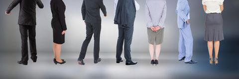 Group of Business People standing with moody background Royalty Free Stock Image