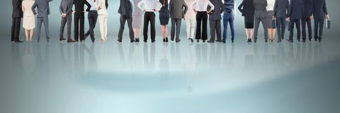 Group of Business People standing on reflective surface Royalty Free Stock Image