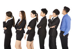 Group of business people standing and waiting in row Stock Photos