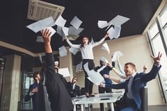 Happy business team celebrating victory in office. woman stand on table stock images