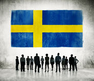 Group of Business People and Swedish Flag.  Royalty Free Stock Image