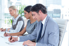 Group of business people taking notes Royalty Free Stock Photo