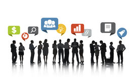 Group of Business People Talking. And Business Related Symbols Above Royalty Free Stock Photo