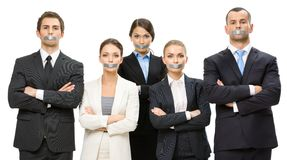Group of business people with taped mouths Stock Images