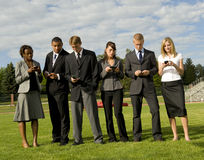 Group of Business People on their Cell Phones. Business Group On Phones statnding royalty free stock image