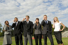 Group of Business People on their Cellphones Stock Photos