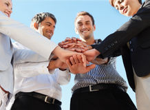 Group of business people with their hands together Stock Images