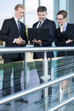 Group of business people using laptop outdoors Stock Photo