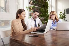 Group of business people using laptop while working in the office royalty free stock photography