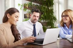 Group of business people using laptop while working in the office stock images