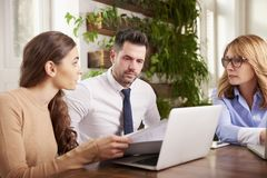 Group of business people using laptop while working in the office stock photos