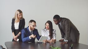 Group of business people using tablet computer during a meeting.  stock footage