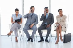Group of business people in a waiting room Stock Images