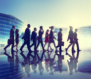 Group of Business People Walking Back Lit Concept Royalty Free Stock Photo
