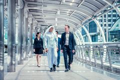 Business people walking in the city and talk about business future. multi culture of business people, African, Caucasian and Asian. Group of business people royalty free stock images