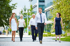 Group of business people walking Royalty Free Stock Photos