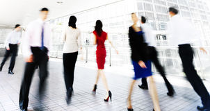 Group of Business People Walking Indoor Royalty Free Stock Image