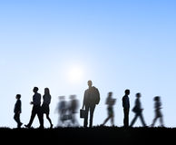 Group of Business People Walking Outdoors Stock Photos