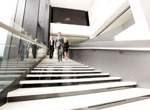 Group of business people walking at stairs Royalty Free Stock Photography