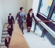Group of business people walking at stairs Stock Photos