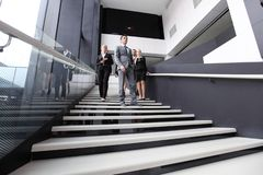 Group of business people walking at stairs stock images