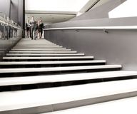 Group of business people walking at stairs Stock Image