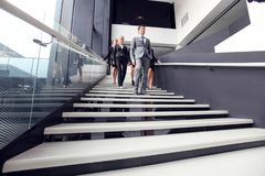 Group of business people walking at stairs royalty free stock image