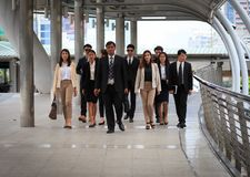 Group of business people walking together with confident. They f royalty free stock images