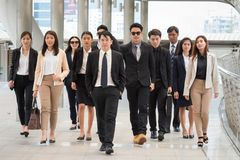 Group of business people walking together with confident. They f. Group of business people walking together with confident. They  on their goal and mission.CEO royalty free stock photography
