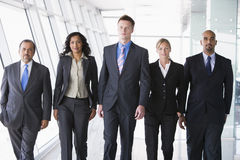 Group of business people walking towards camera Stock Image