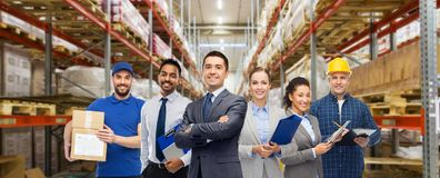Group of business people and warehouse workers stock image