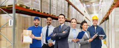 Group of business people and warehouse workers stock images