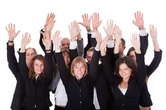 Group of business people waving in acknowledgment Stock Photos