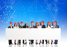 Group of business people with white empty board Stock Image