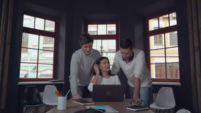 Group of business people at work. Young business team discussing new project. Two coworkers male standing near working place professional young smiling friend stock video footage