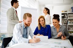 Group of business people working as team in office stock photography