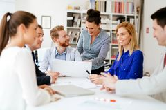 Group of business people working as team in office royalty free stock photography