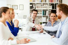 Group of business people working as team in office stock image