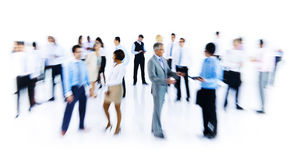 Group Of Business People Working Blurred Motion Indoors Royalty Free Stock Photography