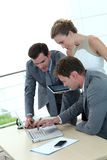 Group of business people working on laptop Stock Photos