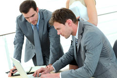 Group of business people working on laptop Royalty Free Stock Photo