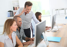 Group of business people working at office Stock Images