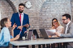 Business people working in office and discussing new ideas stock image