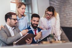 Business people working in office and discussing new ideas royalty free stock photo