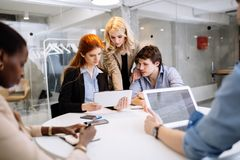 Group of business people working in office. And discussing new ideas Stock Images
