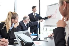 Business presentation at flipchart royalty free stock photography
